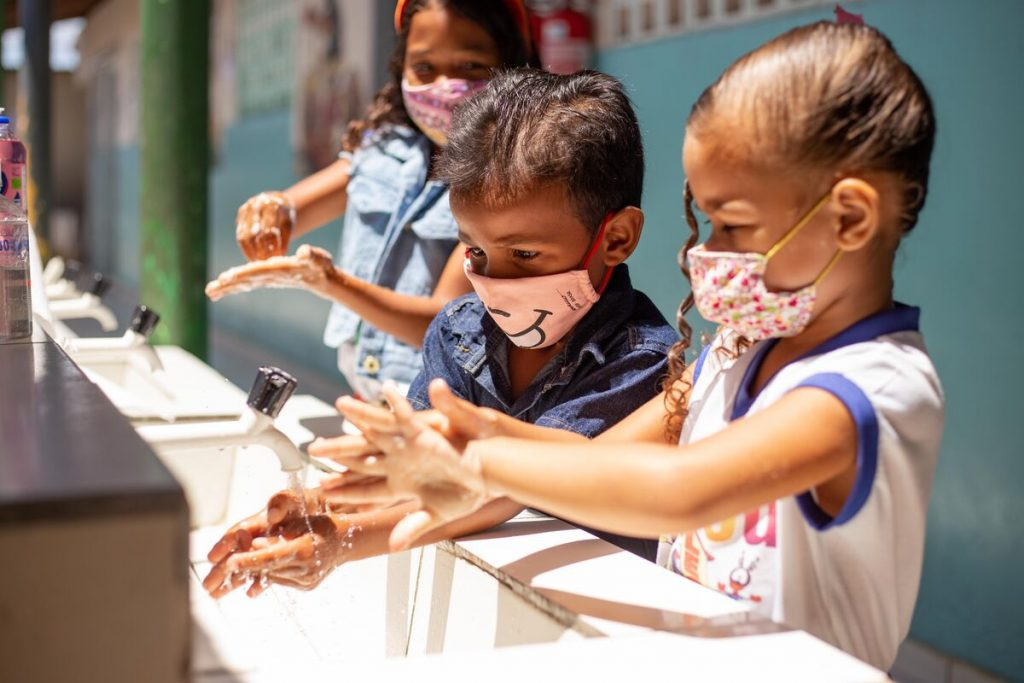 Compassion children washing hands during pandemic