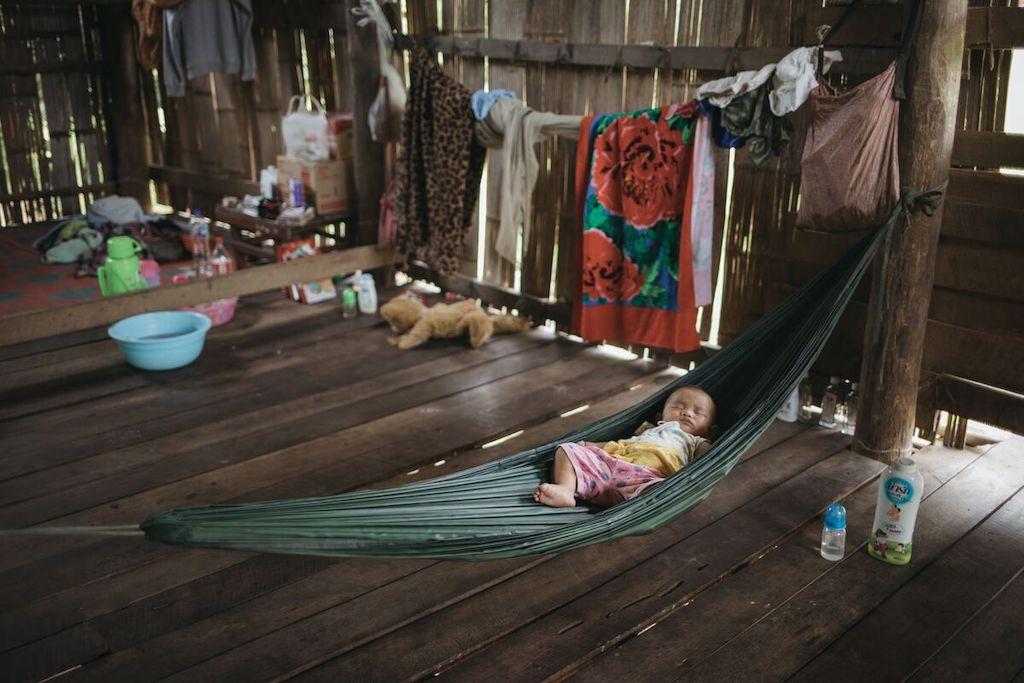 Baby Sathinee in Thailand sleeps in a hammock.
