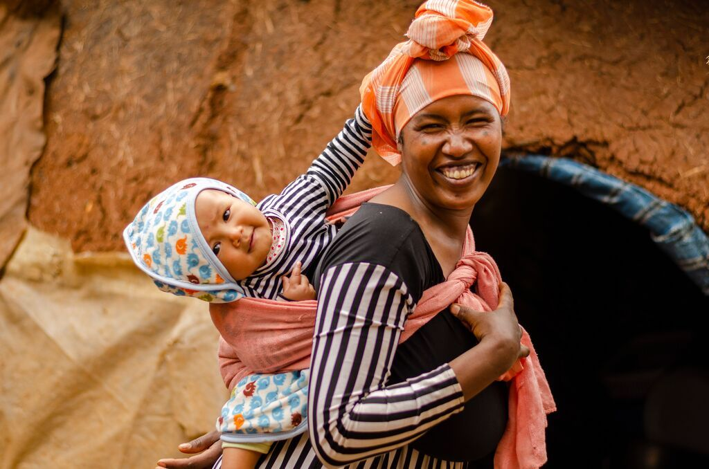 In Ethiopia, a mom carries her baby on her back using a cloth.