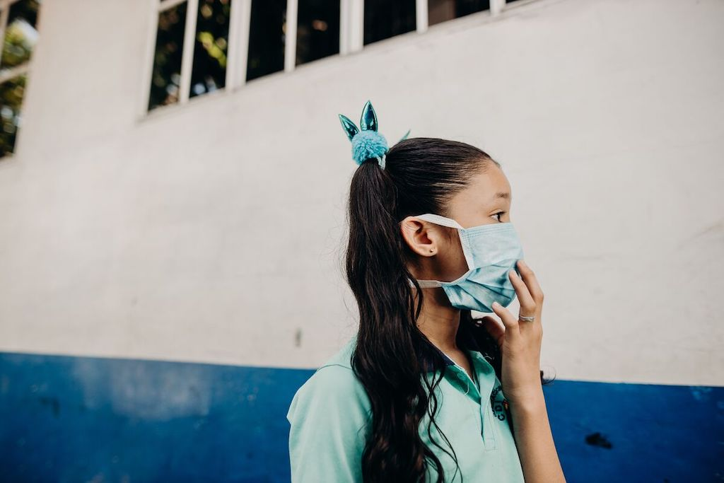 A girl wearing a protective face mask