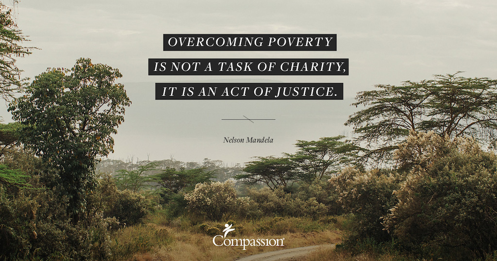 "A dry bush landscape. Quote on image says: ""Overcoming poverty is not a task of charity, it is an act of justice."" – Nelson Mandela"