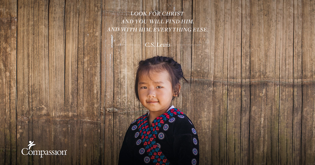 "A young Thai girl in traditional clothing stands against a wooden wall. Quote on image says: ""Look for Christ and you will find Him. And with Him, everything else."" – C.S. Lewis"
