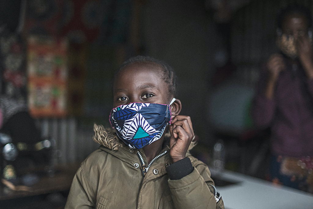 A child wearing a cloth protective face mask