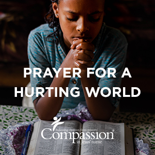 "Cover graphic for the ""Prayer for a Hurting World"" devotional, which includes the title, Compassion's logo and an image of an Ethiopian girl praying with a Bible open on the table in front of her."
