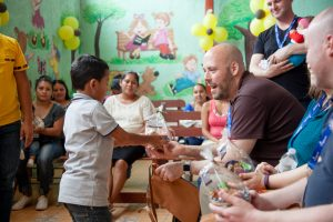 Pastor Jeff Jantzi receives a gift from a Guatemalan boy at a Compassion centre.