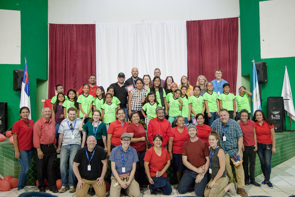 A group of Canadian pastors and Compassion staff with Guatemalan staff and children at a Compassion centre at a local church.