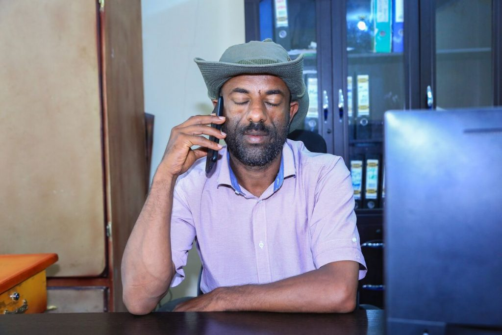 Latarik, local Compassion centre director, prays for struggling children and youth over the phone.
