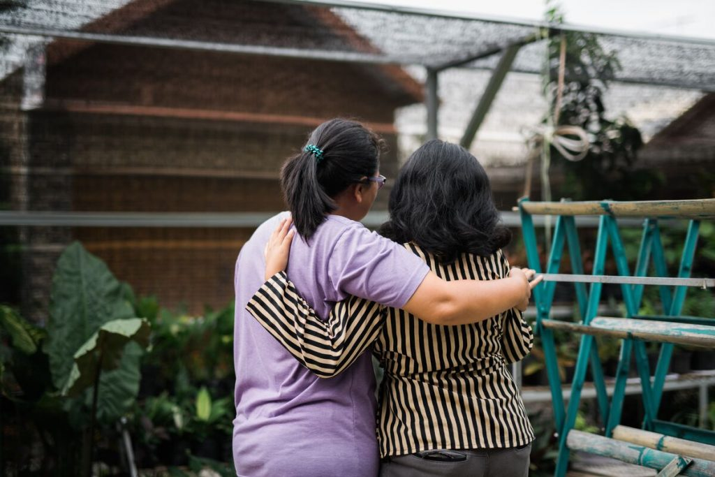 Liza with her caregiver, Ria.