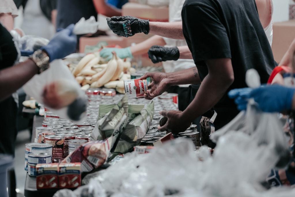 Volunteers sort food at a food bank.