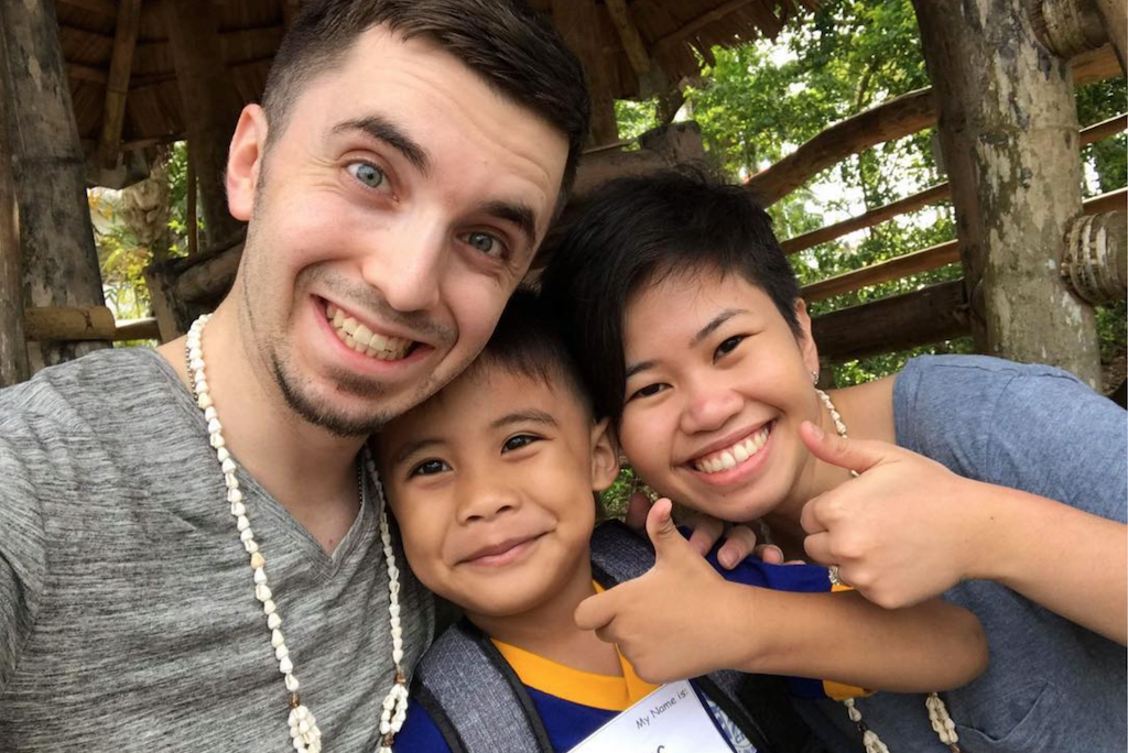 Timothy, Abigail and their sponsored child James take a selfie.
