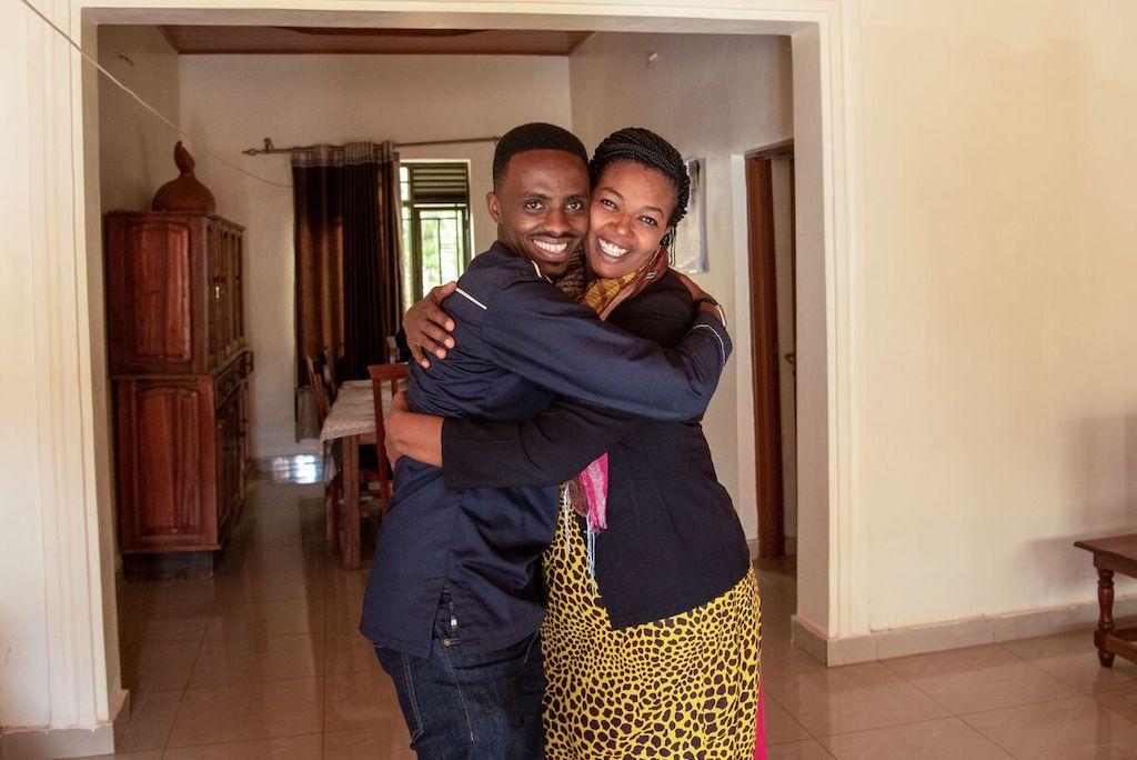 Christian and Pascasie share a joyful embrace.