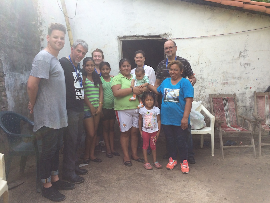 A group of Canadians visit the home of a Compassion beneficiary in Boliva.