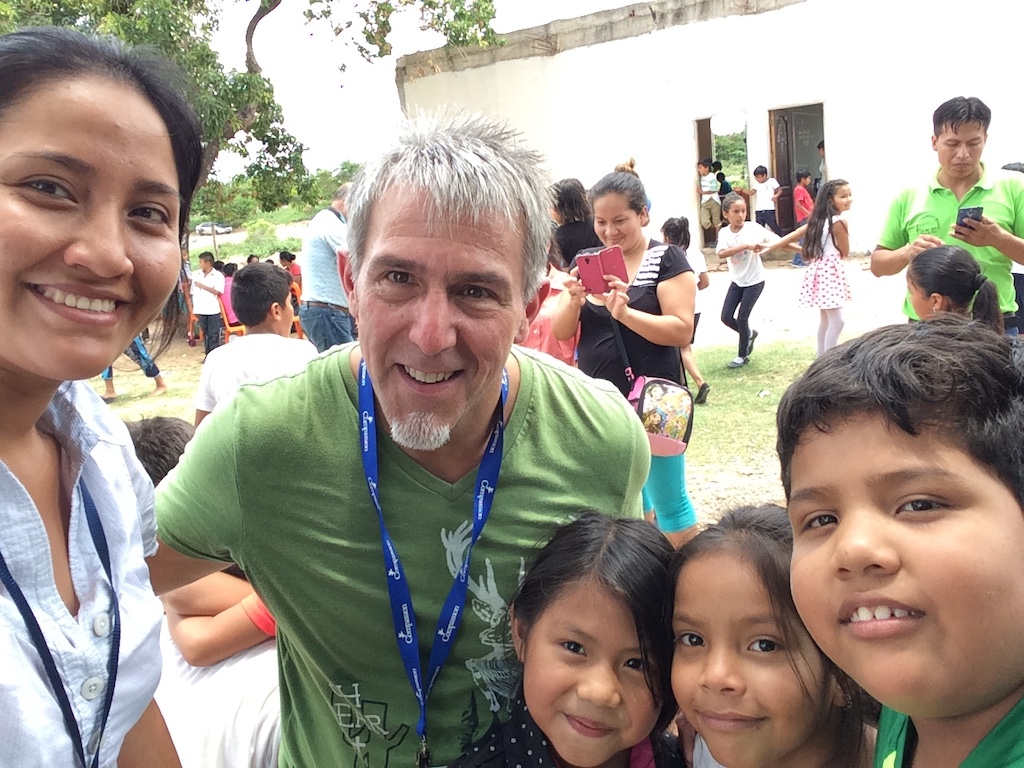 Pastor Brad with a group of children and a Compassion staff member in Bolivia.