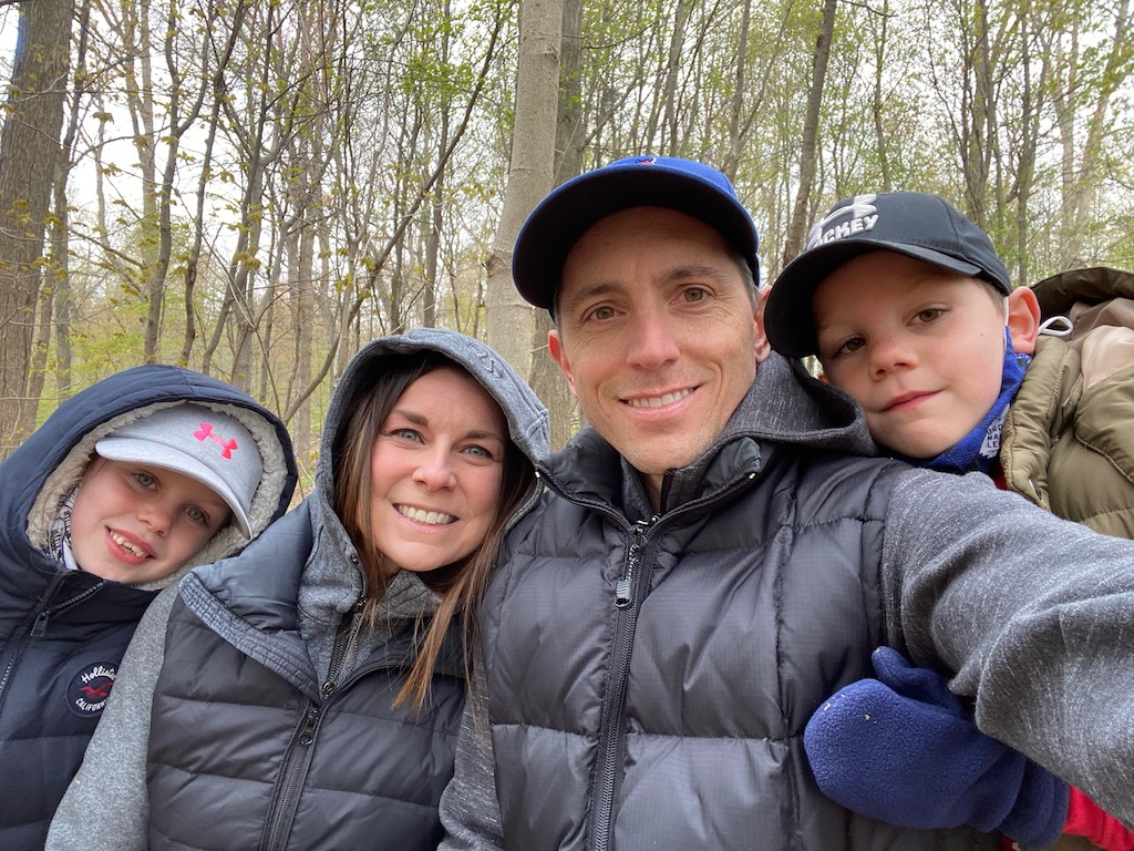John and his family on a hike in the forest.