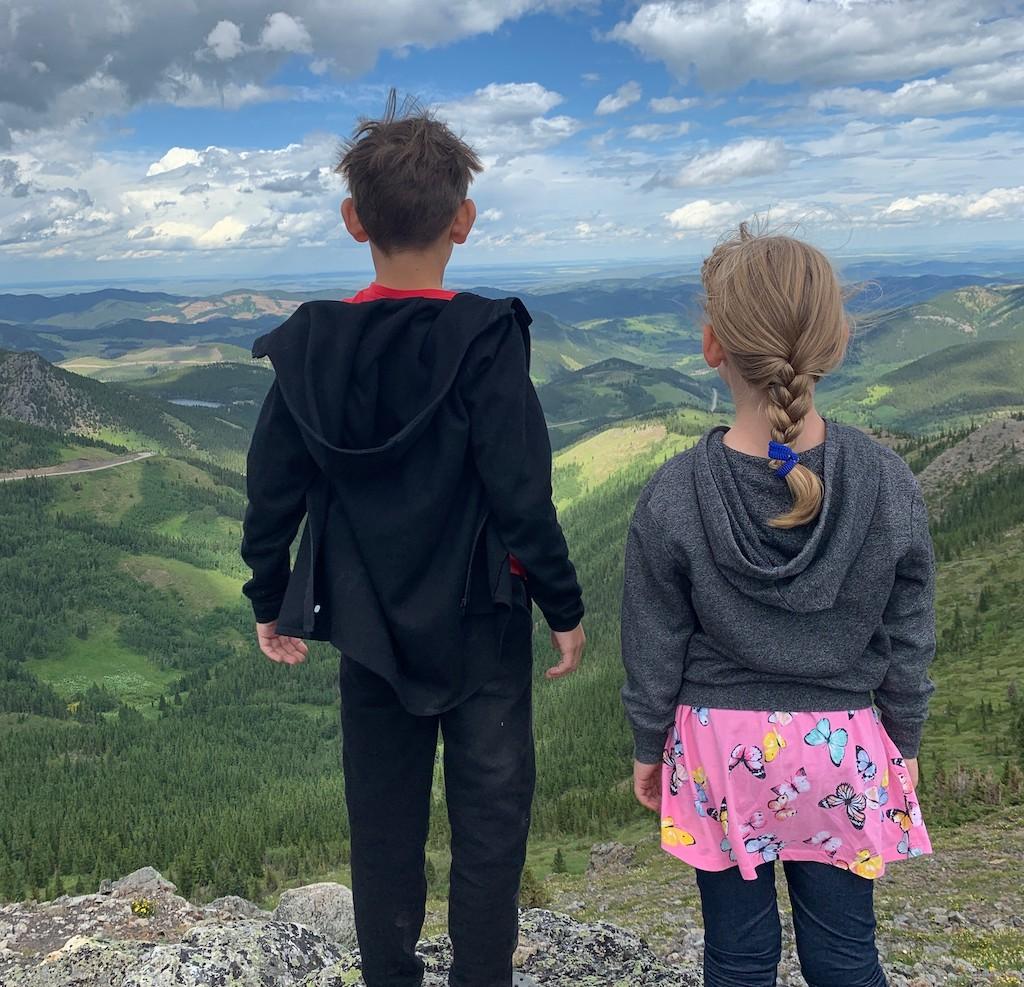 Karla's kids facing the mountains.