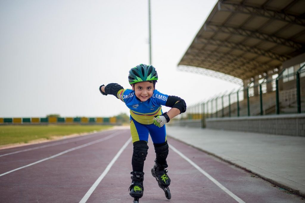 A young boy skating on a track.