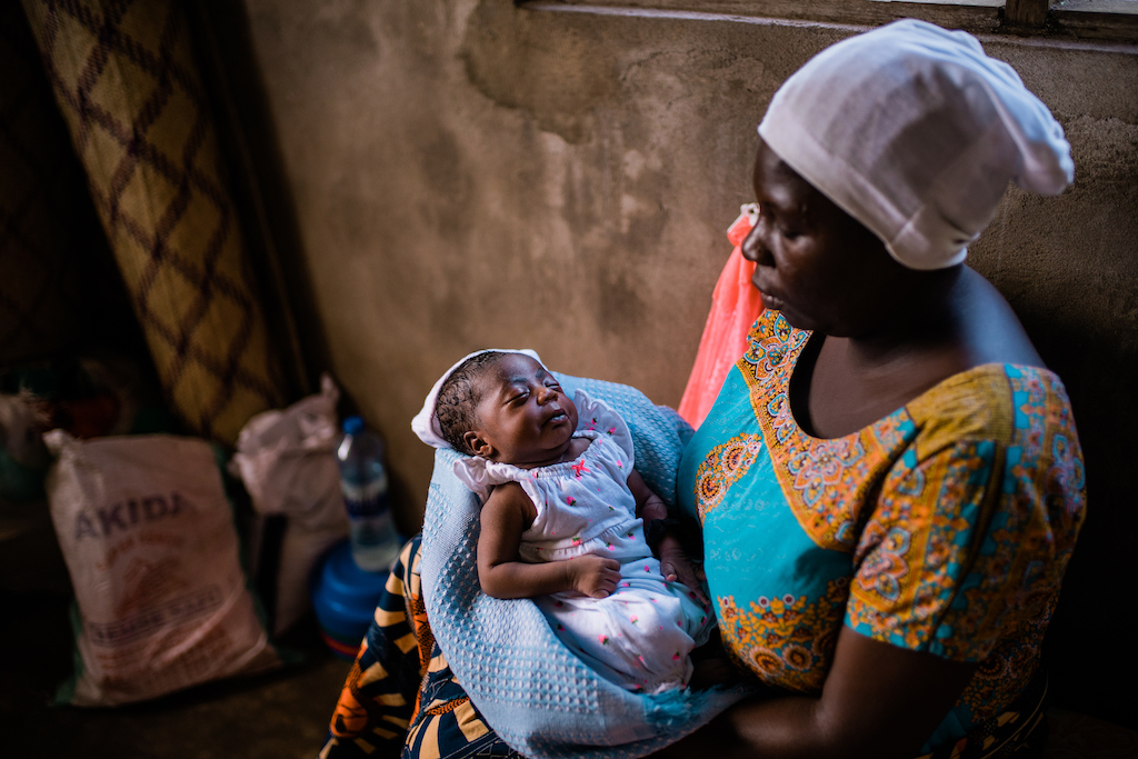 A mother in Tanzania holds her baby.
