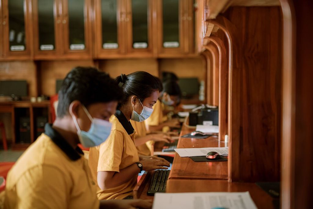 Youth in Indonesia working in a computer lab.