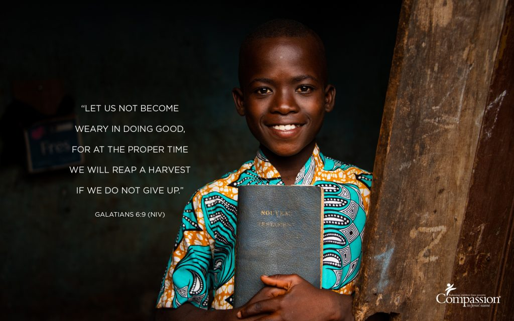 A photo of a boy in Togo holding a Bible, with the text of Galatians 6:9 overlaid on the image.