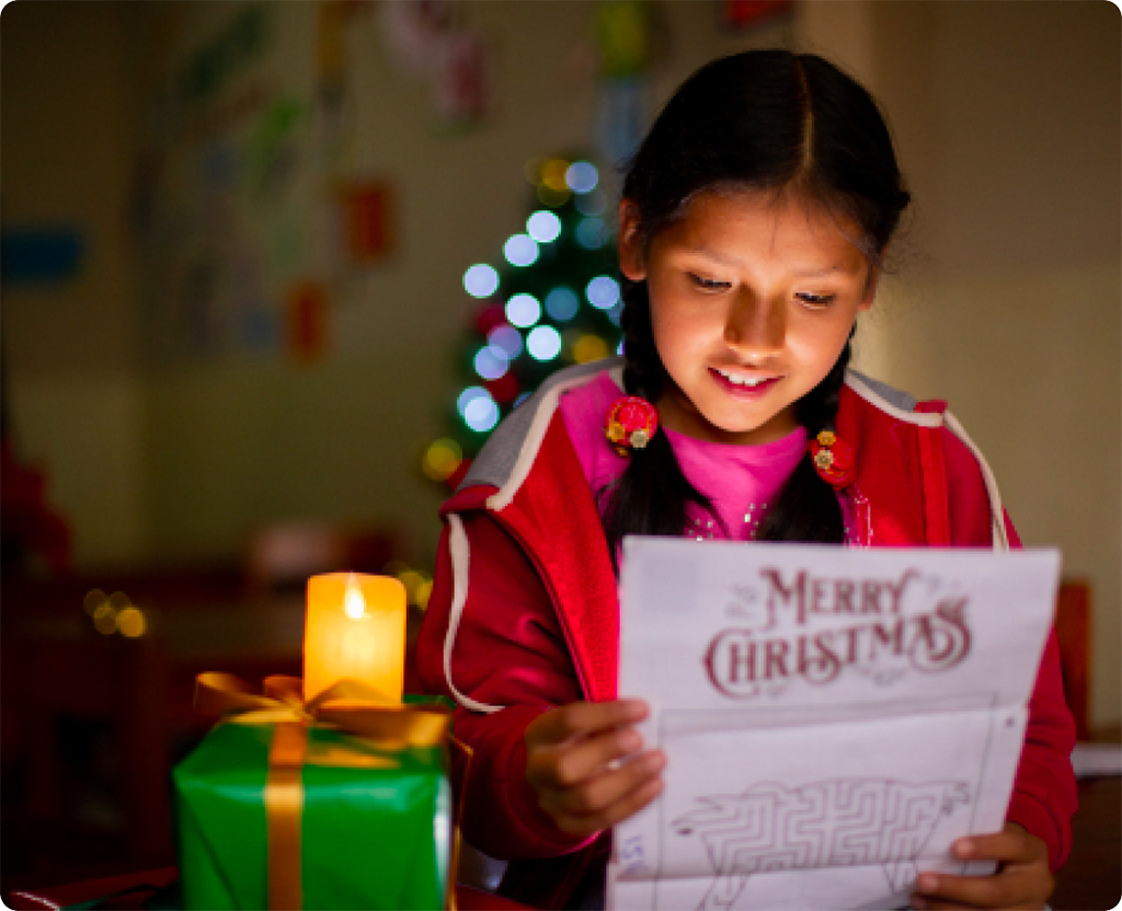 Nery reads a Christmas letter from her sponsor