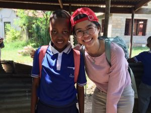 Alyssa with her sponsored child, Happyness, in Tanzania.