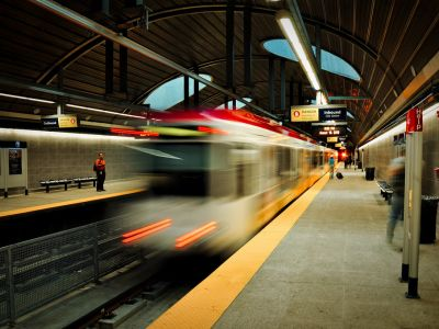 Train pulling away from the LRT platform at night