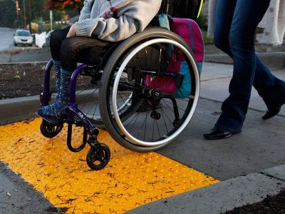 Tactile pavement and yellow wheelchair ramp