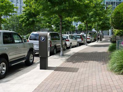parallel street parking next to a textured pedestrian way