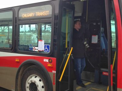 patron using the wheelchair accessible lift on the new buses to exit the bus safely