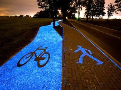 A pathway with bikes on 1 side & pedestrians on another. Glow in the dark icons and paving.