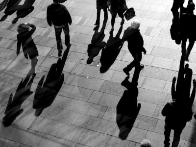 Pedestrians from above, walking on paving stones.
