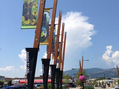 Banners and art on a streetlight pole