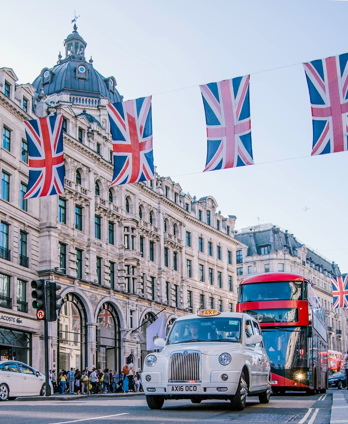 uk flags over double decker bus