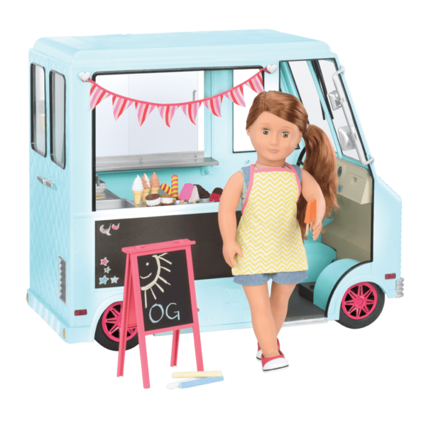 Adriana standing outside ice cream truck wearing apron