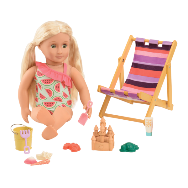 Ginger sitting and playing with beach toys