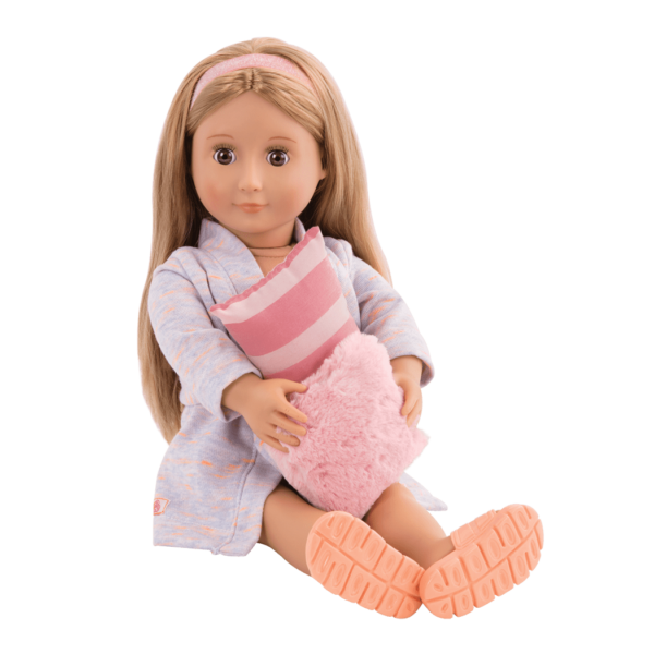 Arianna sitting and holding pillow