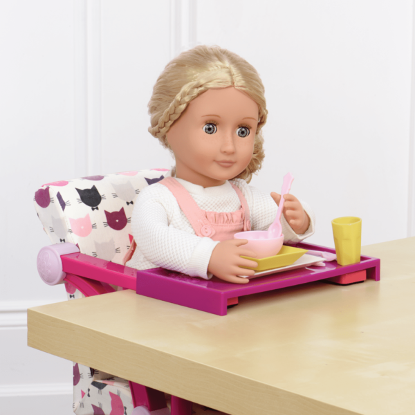 Coral sitting in Let's Hang Clip-On Chair