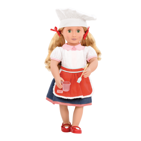 Jenny wearing chef hat and apron
