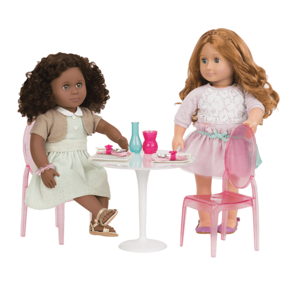 Nahla and Liana sitting at table