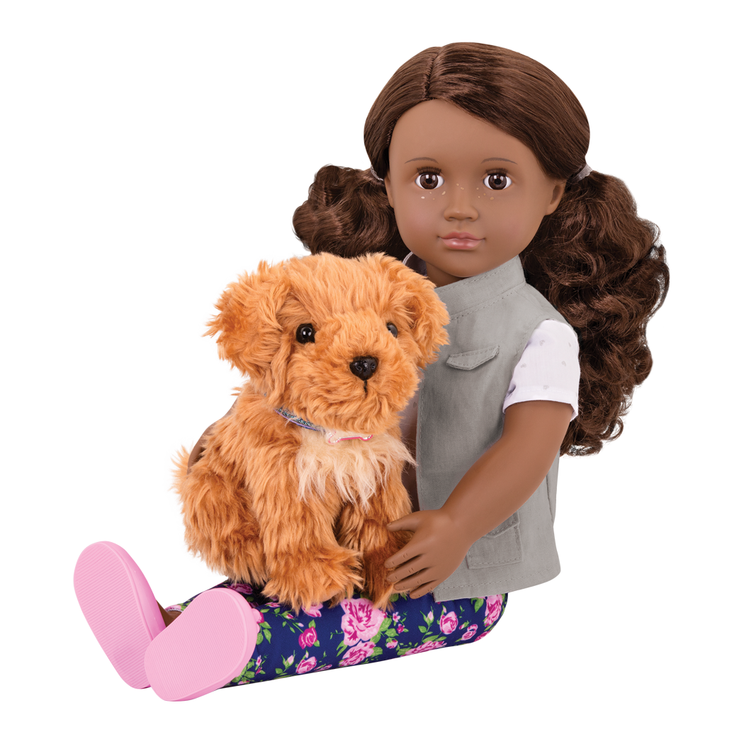Malia sitting with Poodle in her lap