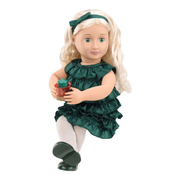 Girl holding Audrey Ann doll and reading storybook