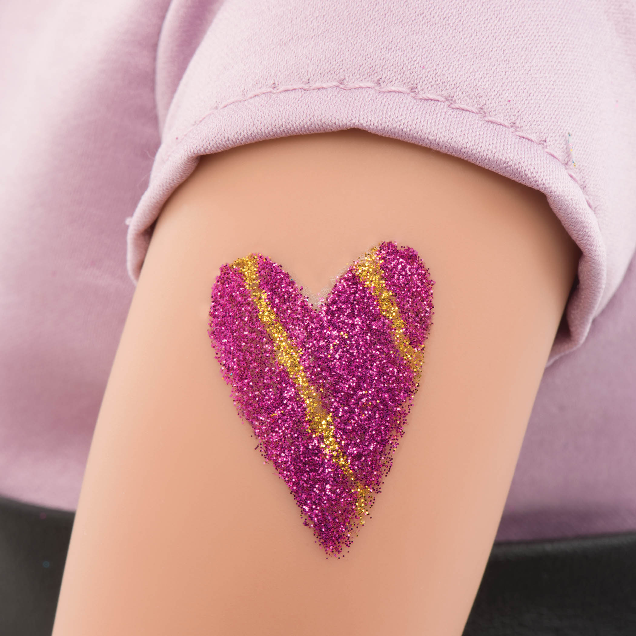Detail of glitter tattoo on arm