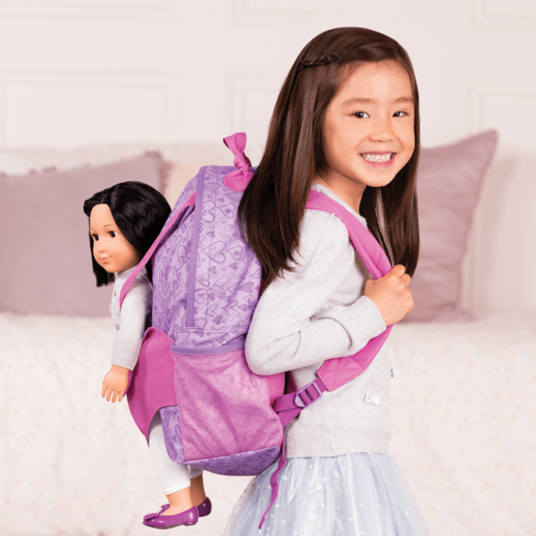 Girl using Hop On Carrier Backpack - Purple Hearts