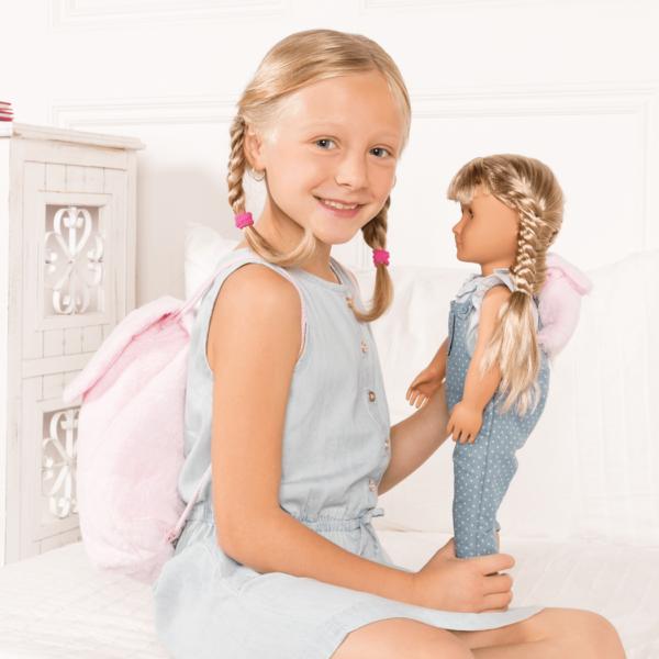 Girl playing with Lorelei wearing matching backpacks