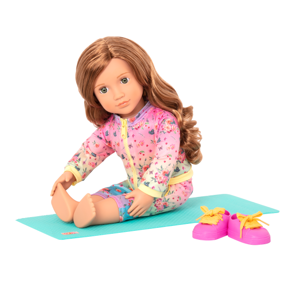 Lucy Grace stretching on yoga mat