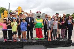 Transportation Minister Steven Del Duca, Elmer the Safety Elephant and friends give thumbs up to the new rules of the road