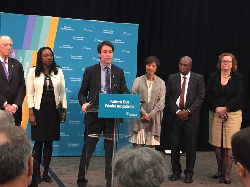 At the podium Dr. Eric Hoskins Minister of Health and Long Term Care announcing the recommendations for changes in Scarborough and Durham region