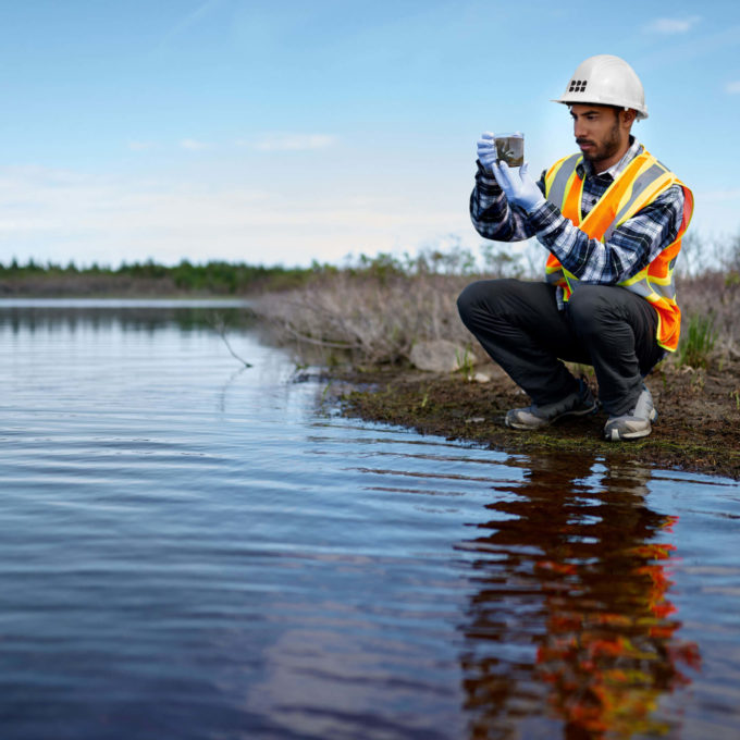 Environment - Man taking samples in a shallow river