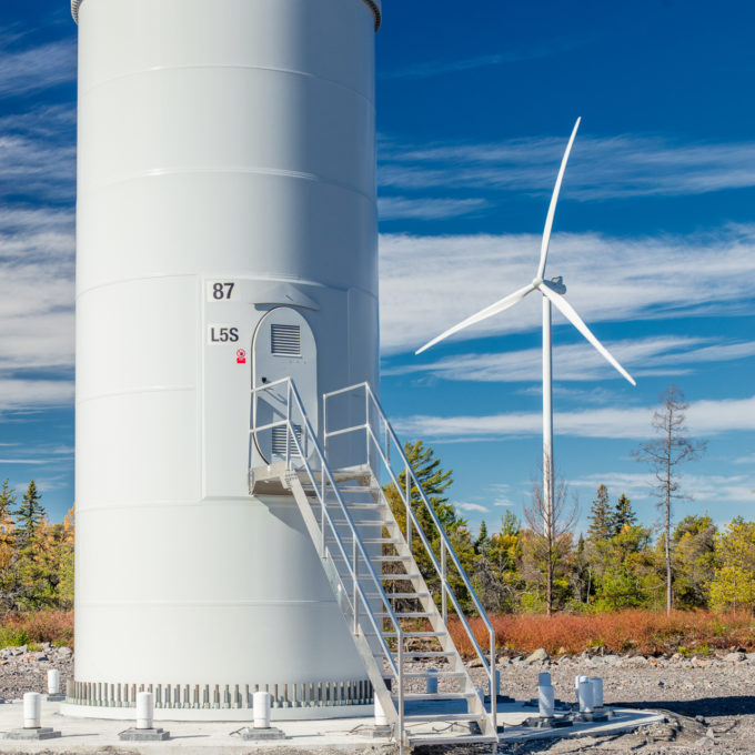 Henvey Inlet wind turbine base - Blue sky and forest background