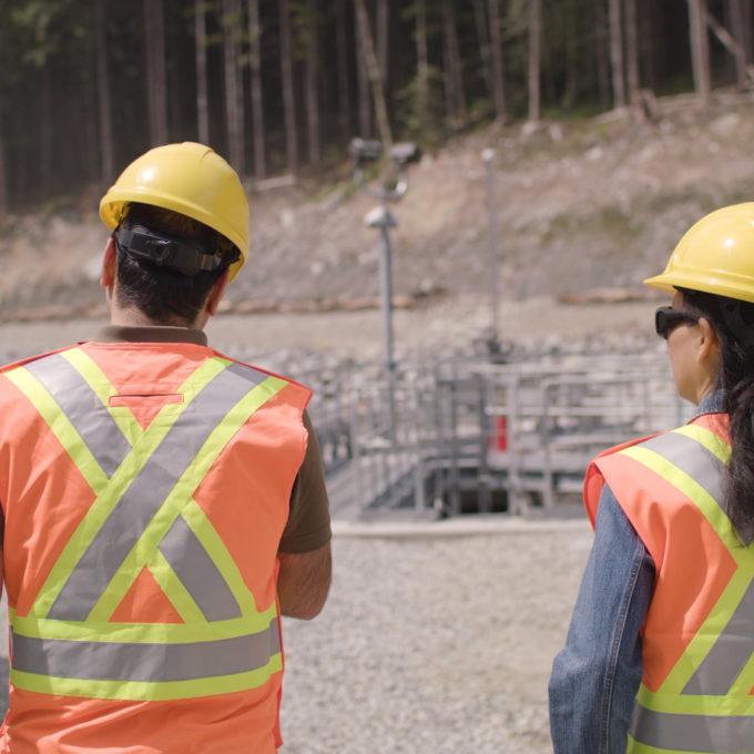 Hydropower plant - Two employees walking